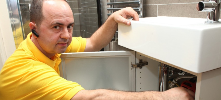 Local trustworthy plumber resolving customer's plumbing issues